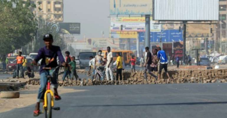The protests in Sudan come amid soaring inflation, power cuts and bread shortages.  By ASHRAF SHAZLY (AFP)