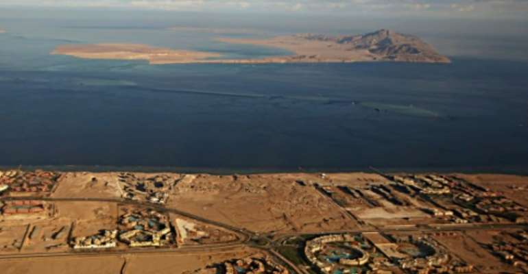 The Red Sea islands of Tiran (foreground) and Sanafir (background) are seen in the Strait of Tiran between Egypt's Sinai Peninsula and Saudi Arabia.  By STRINGER (AFP/File)