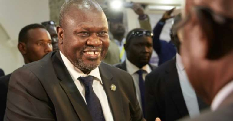 The rejection of a peace offer by South Sudan rebel chief Riek Machar (L) dashes hopes of breaking a deadlock and ending a six-year conflict that has left at least 380,000 people dead.  By Alex McBride (AFP/File)