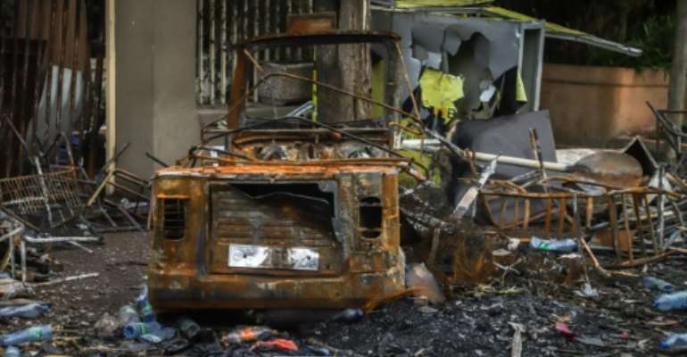 The remains of a burned-out car and building in the Oromia town of Shashamene, where violent protests erupted following the killing of singer Hachalu Hundessa.  By - (AFP)