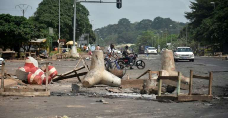 The remains of a street barricade in Yamoussoukro, the Ivorian capital, after post-election clashes.  By SIA KAMBOU (AFP)
