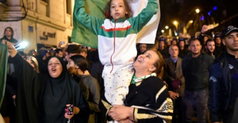 The resignation of Algerian leader Abdelaziz Bouteflika sparked scenes of jubilation in the capital.  By RYAD KRAMDI (AFP)