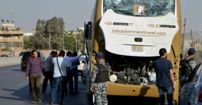 The roadside bomb blast near Egypt's pyramids injured 17 people including foreign tourists.  By Sayed HASAN (AFP)