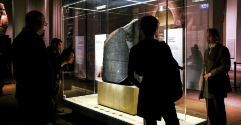 The Rosetta Stone, discovered by French troops and housed today at the British Museum, unlocked the study of ancient Egypt.  By Amir MAKAR (AFP/File)