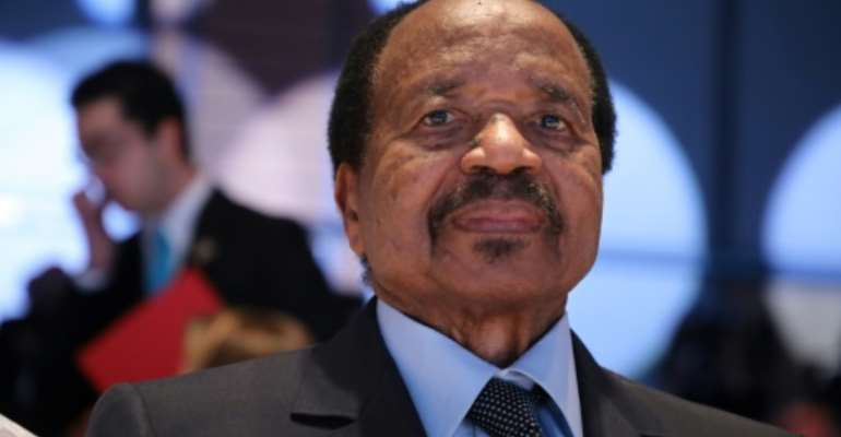 The RSF described Wazizi's death as the country's worst assault on journalists in a decade; pictured is an October 2019 file image of President Paul Biya.  By Ludovic MARIN (AFP/File)