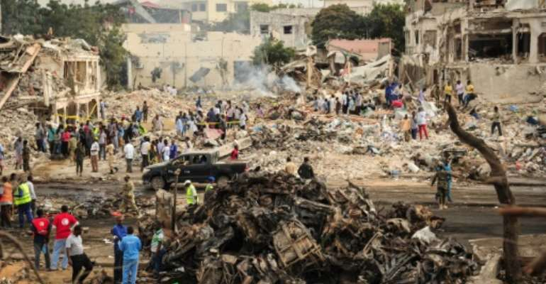 The scene of the explosion of a truck bomb in the centre of Mogadishu on October 15, 2017.  By Mohamed ABDIWAHAB (AFP)