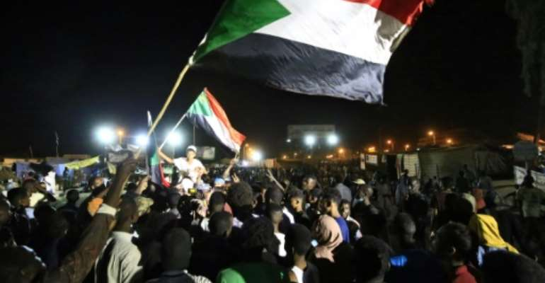 The shooting comes after Sudan's military rulers and civilian protest leaders reached an agreement in the early hours of Wednesday on forming a transitional government.  By ASHRAF SHAZLY (AFP)
