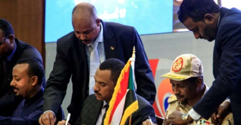 The signing of a transitional constitution in Sudan has opened the way for civilian rule in the once-pariah country.  By Ebrahim HAMID (AFP)