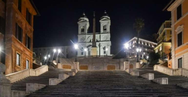 The Spanish Steps in Rome are deserted after sunset, after Italy imposed unprecedented restrictions to check the spread of the new coronavirus and the death toll soared to 631 people.  By Tiziana FABI (AFP)