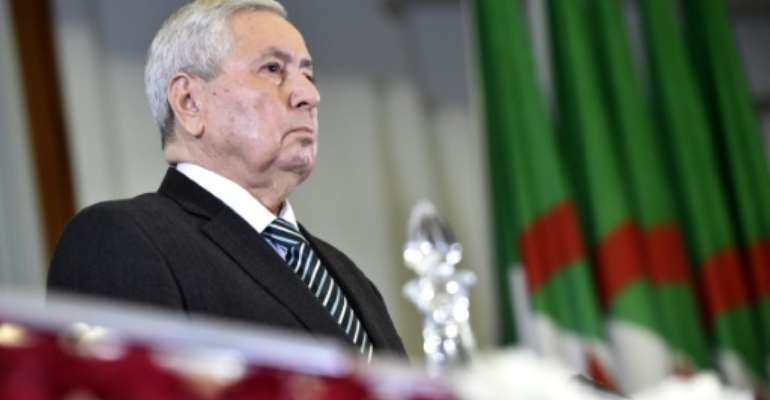 The speaker of the upper house of the Algerian parliament, Abdelkader Bensalah, has been elected by fellow MPs as the country's first new leader in 20 years after the resignation of Abdelaziz Bouteflika in the face of mass protests.  By RYAD KRAMDI (AFP)