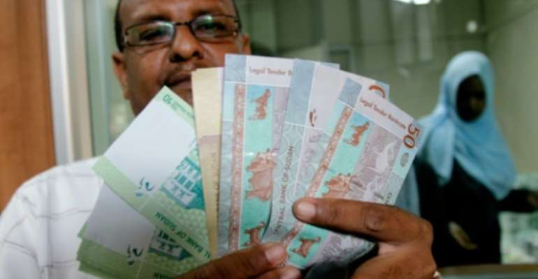 The Sudanese pound has been hit by an acute lack of foreign currency.  By ASHRAF SHAZLY (AFP/File)