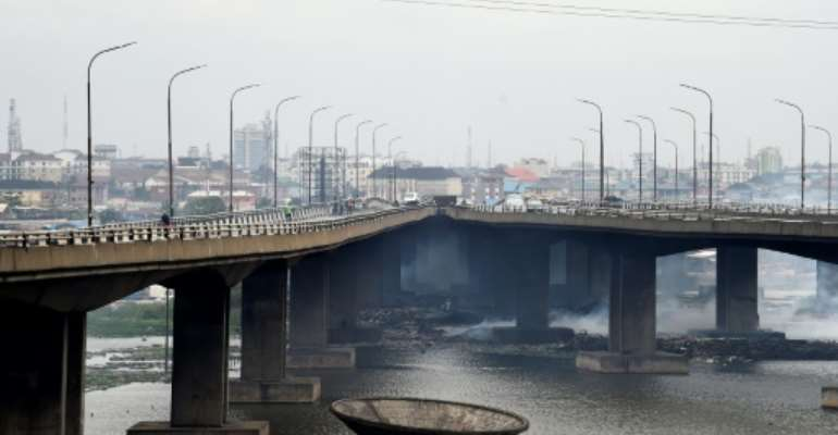 The Third Mainland Bridge is a key link to the city's business district and is going to partially closed for months for repairs.  By PIUS UTOMI EKPEI (AFP)