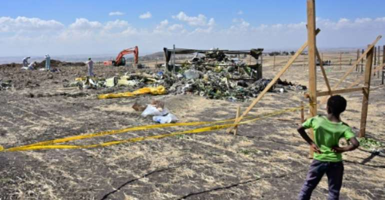 The two planes' flight recorders provided the strongest indication yet that an anti-stall system malfunctioned in both the Ethiopian Airlines crash of March 10, 2019 -- the aftermath of which is seen here -- and Lion Air's 2018 crash in Indonesia.  By TONY KARUMBA (AFP/File)