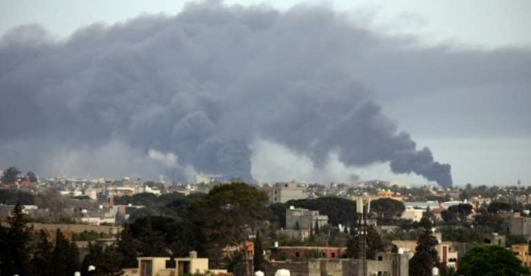 The United Nations Support Mission in Libya (UNSMIL) called the bombardment 'an all too familiar but frightening spectacle'. By Mahmud TURKIA (AFP)