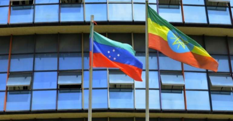 The unofficial green, blue and red flag of the advocated region for the Sidama ethnic group (L), the largest in southern Ethiopia, flies next to the Ethiopian national standard at Hawassa city.  By Michael TEWELDE (AFP)