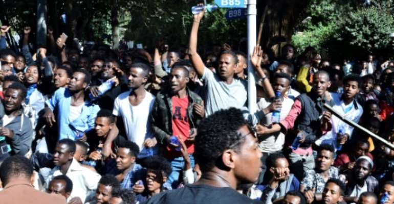 The unrest was triggered when media mogul Jawar Mohammed, an Oromo activist, claimed that security forces had plotted an attack against him. Shown here are supporters at a rally outside his home.  By STRINGER (AFP/File)