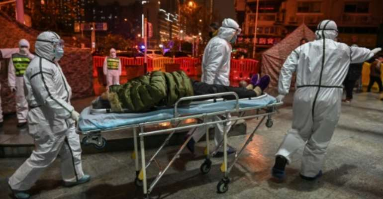 The virus first emerged in the Chinese city of Wuhan in December.  By Hector RETAMAL (AFP/File)