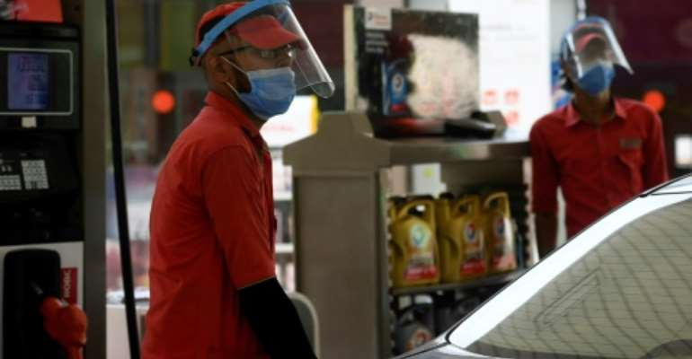 The virus has killed nearly 550,000 people.  By Aamir QURESHI (AFP/File)