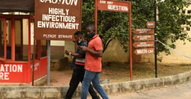 The Yaba Mainland Hospital is festooned with signs warning of the infection danger.  By PIUS UTOMI EKPEI (AFP)
