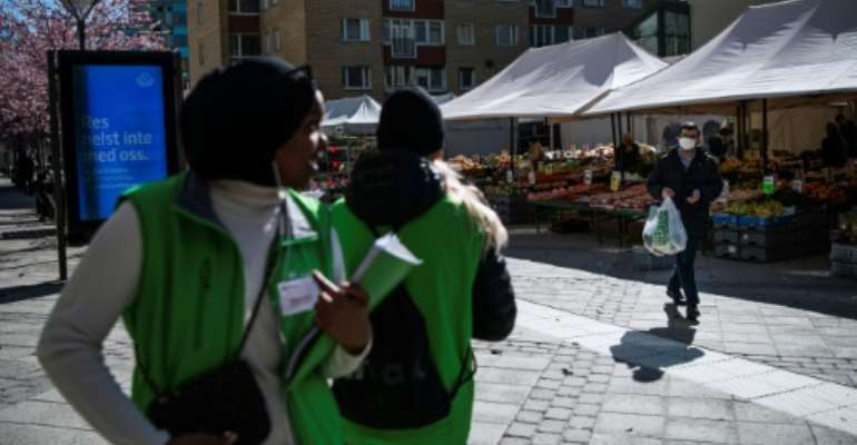 The 'youth ambassadors carry flyers with information about the disease and take up positions on streets and squares to approach pedestrians.  By Jonathan NACKSTRAND (AFP)