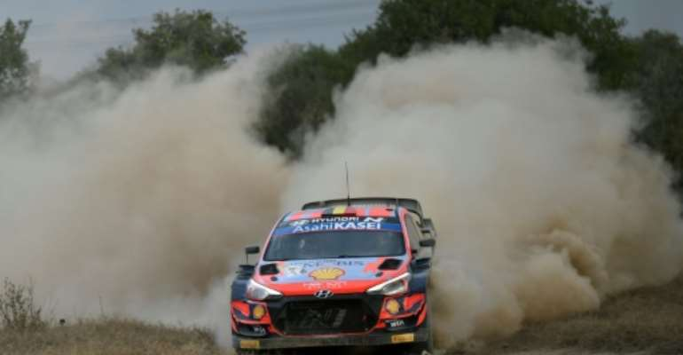 Thierry Neuville steered his way through the stormy conditions to retain his Safari Rally lead as he chases a first season win.  By TONY KARUMBA (AFP)