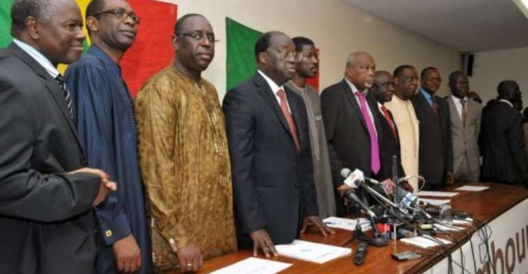 Eight members of the Senegalese opposition at a news conference in Dakar last month.  By Seyllou (AFP)