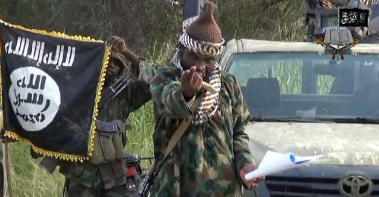 A screengrab taken on October 2, 2014 from a video released by Boko Haram and obtained by AFP shows the leader of the Nigerian Islamist extremist group, Abubakar Shekau.  By  (Boko Haram/AFP/File)