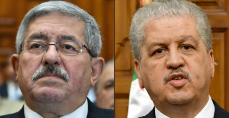 This combination of pictures created on December 10, 2019 shows file photos of then newly appointed Algerian prime minister Ahmed Ouyahia attending a congress session in the capital Algiers on September 4, 2017 and Algerian Prime Minister Abdelmalek Sellal giving a press conference on March 9, 2017 in Tunis.  By RYAD KRAMDI, FETHI BELAID (AFP/File)