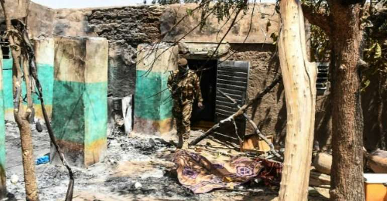 Those responsible for the massacre in Ogossagou, central Mali also burned down the village.  By Handout (MALIAN PRESIDENCY/AFP)
