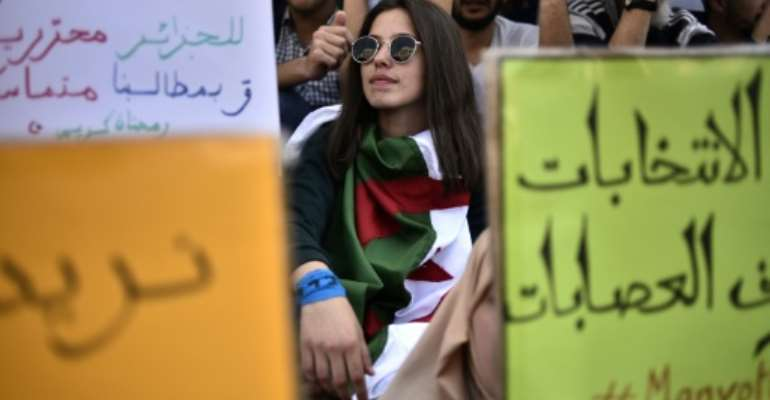 Thousands of Algerian students protested in the capital Algiers on Tuesday.  By RYAD KRAMDI (AFP)