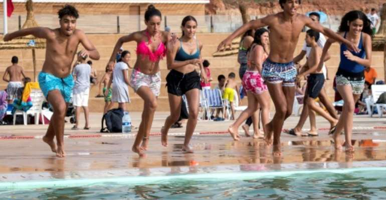 Thousands of Moroccans are flocking to the artificial pools carved into the rocky outcropping of the urban corniche in the capital Rabat.  By FADEL SENNA (AFP)