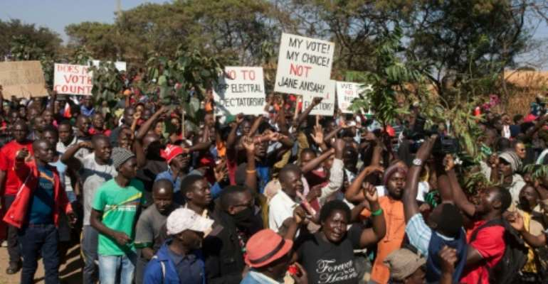 Thousands of opposition parties supporters participate in a protest in Malawi's capital Lilongwe, to force Malawi Electoral Commission chairperson Jane Ansah to resign and to protest the alleged use of correction fluid in the marked ballots.  By AMOS GUMULIRA (AFP)