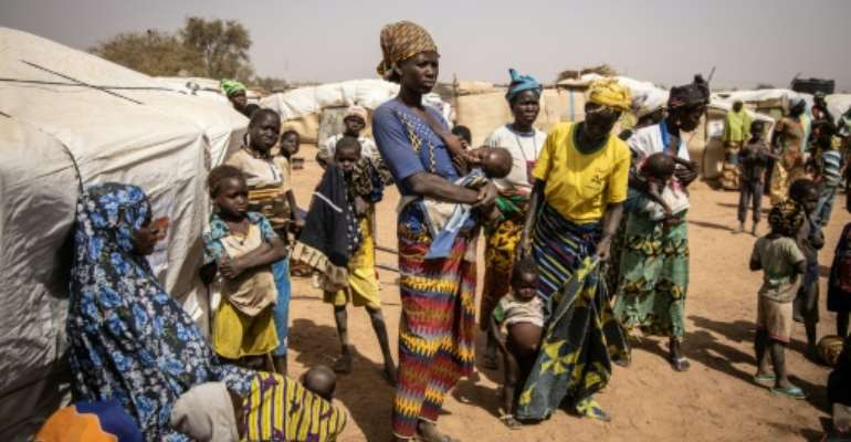 Thousands of people have fled the jihadist onslaught in northern Burkina Faso, holing up in a camp in the town of Barsalogho.  By OLYMPIA DE MAISMONT (AFP)