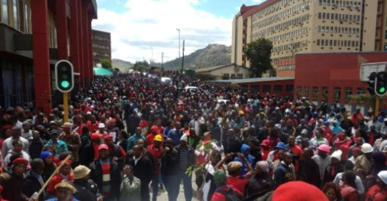 Thousands of Public Servants and teachers march through the streets of Mbabane.  By MONGI ZULU (AFP)