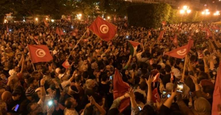 Thousands of Tunisians celebrated Saied's win Sunday.  By Fethi Belaid (AFP)