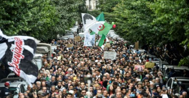 Thousands protested in Algiers Tuesday in the first weekly demonstration since the election of a new president.  By RYAD KRAMDI (AFP)
