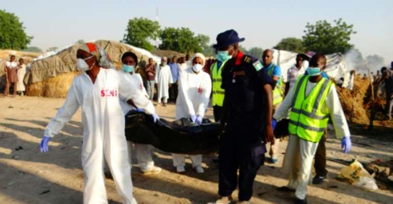 Three female suicide bombers struck in Maiduguri, northeast Nigeria, on October 22, killing 13 people.  By STRINGER (AFP/File)