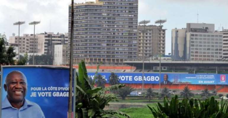 A giant campaign poster for President Laurent Gbagbo in Abidjan.  By Issouf Sanogo (AFP/File)