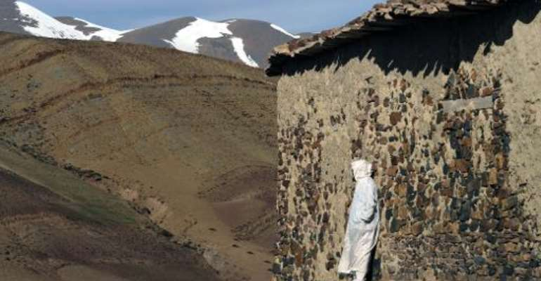 A Moroccan villager stands outside a house in Anfgou, in the High Atlas mountains, on January 11, 2013.  By Fadel Senna (AFP/File)