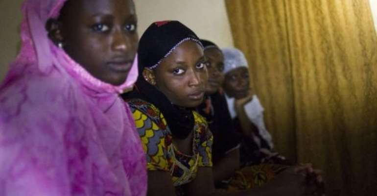 Malian women pose during a dinner in their home, on January 31, 2013, in Timbuktu.  By Fred Dufour (AFP/File)