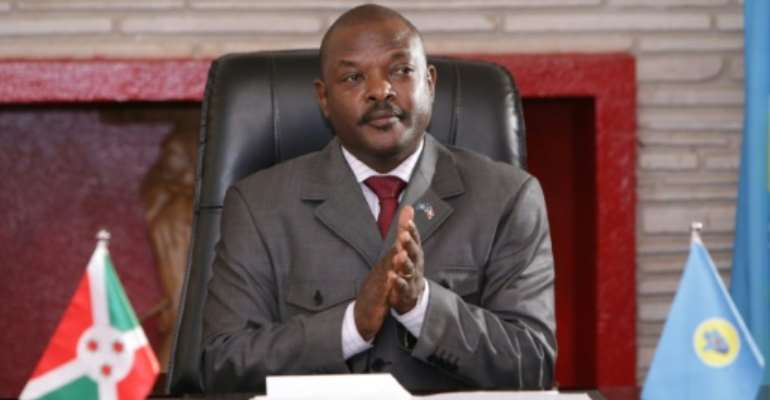 Time for farewell? Burundi President Pierre Nkurunziza, pictured in June 2018, after signing a new constitution that would enable him to run for two more seven-year terms.  By STR (AFP)