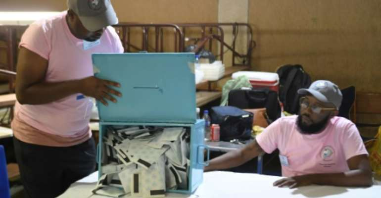 Time to count: Polling officers check ballots in a Gaborone constituency. The vote marks the first time that the 53-year dominance of Botswana Democratic Party is under threat.  By Monirul Bhuiyan (AFP)