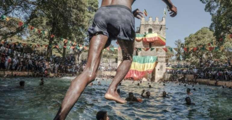 Timkat celebrates the baptism of Jesus in the River Jordan.  By EDUARDO SOTERAS (AFP/File)
