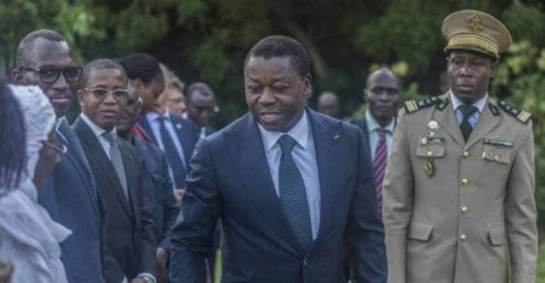 Togolese President Faure Gnassingbe (C) looks set to win another term this year.  By Yanick Folly (AFP)
