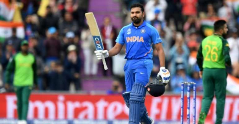Ton-up -- Rohit Sharma celebrates reaching his century during India's six-wicket World Cup win over South Africa.  By Dibyangshu SARKAR (AFP)