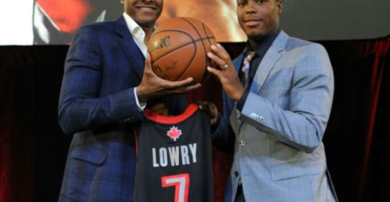 Toronto Raptors president Masai Ujiri, at left alongside Raptors star Kyle Lowry, went from a boyhood in Nigeria to making decisions that could bring the NBA title to Toronto.  By Ron Turenne (NBAE / Getty Images/AFP/File)