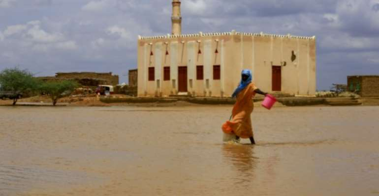 Torrential rains and flooded have battered Sudan this week leaving at least 30 people dead.  By ASHRAF SHAZLY (AFP/File)