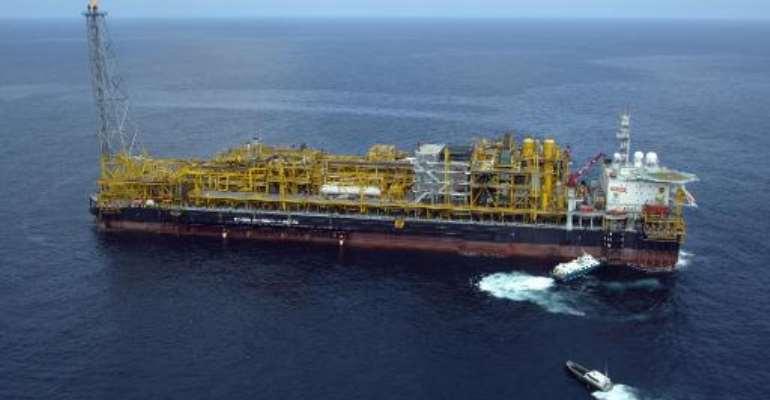 Total's Girassol oil platform on block 17 off Angola on October 16, 2003.  By Martin Bureau (AFP)