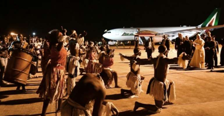 Touching down in Mozambique, Francis was welcomed by a military band and a display of traditional dance.  By Tiziana FABI (AFP)