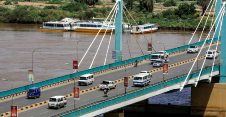 Traffic flows normally across the Mek Nimr Bridge linking Khartoum with Khartoum North, despite the reported coup attempt in the early hours.  By ASHRAF SHAZLY (AFP)